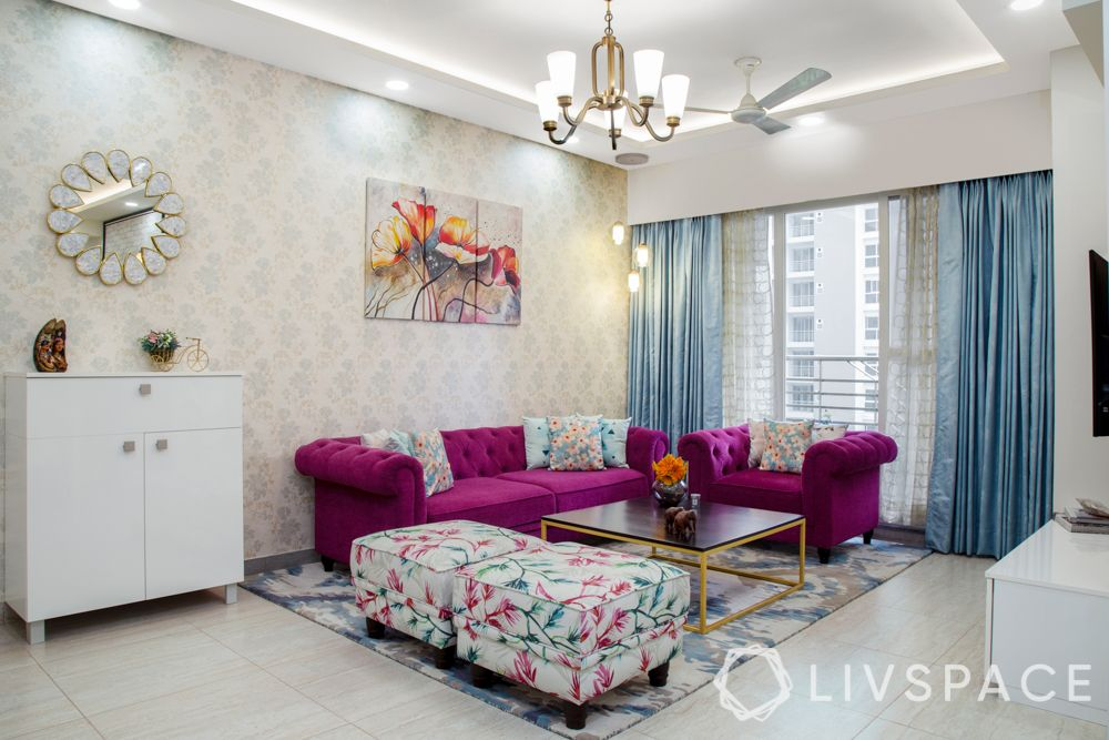 living-room-ideas-area-rug-purple-sifa-floral-seats-gold-wood-coffee-table-blue-curtains-ivory-wallpaper