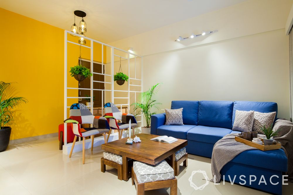 living-room-ideas-multi-functional-furniture-coffee-dining-table-yellow-wall-blue-couch