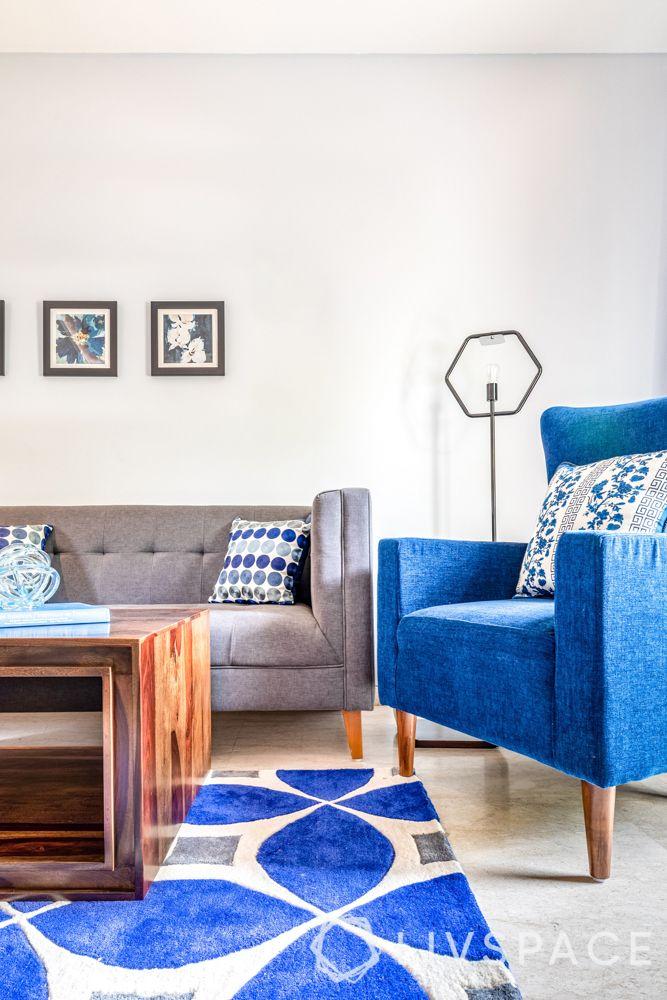 blue armchair-blue rug-black floor lamp