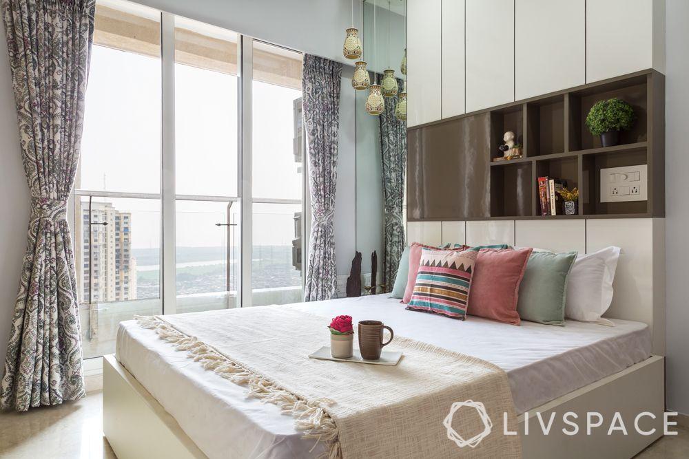 bedroom makeover-stud space cabinet-storage above bed
