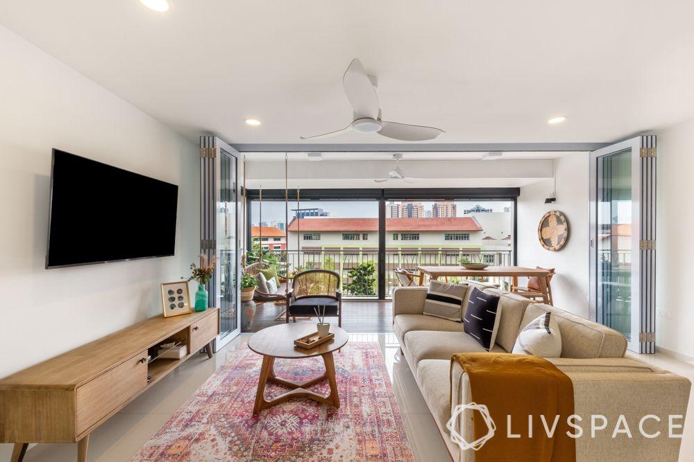 tv-wall-decoration-stand-alone-wooden-unit-minimal-large-rug-folding-doors-balcony