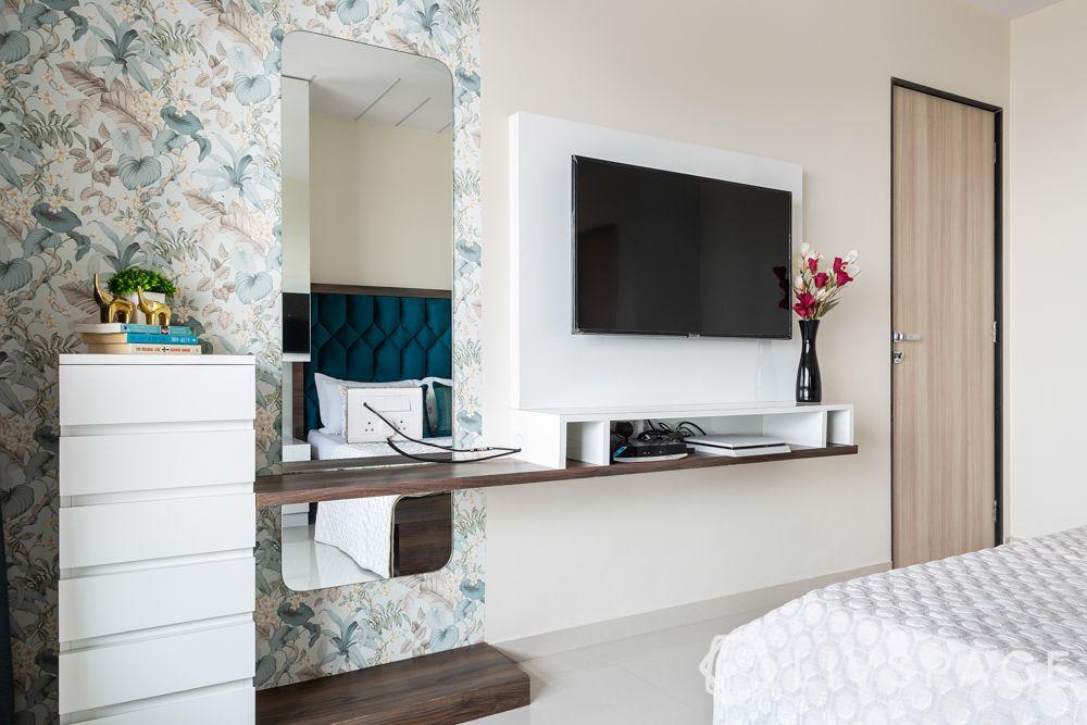 small-house-design-plans-bedroom-tv-dresser-unit-floral wallpaper