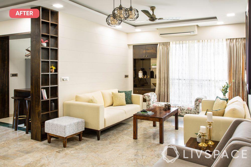 mumbai flat-after photo-minimal glam living room-beige sofas-wooden laminate storage units-metal chandelier