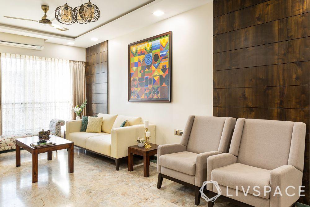 mumbai flat-wooden pattis on walls-cream sofas-wall art