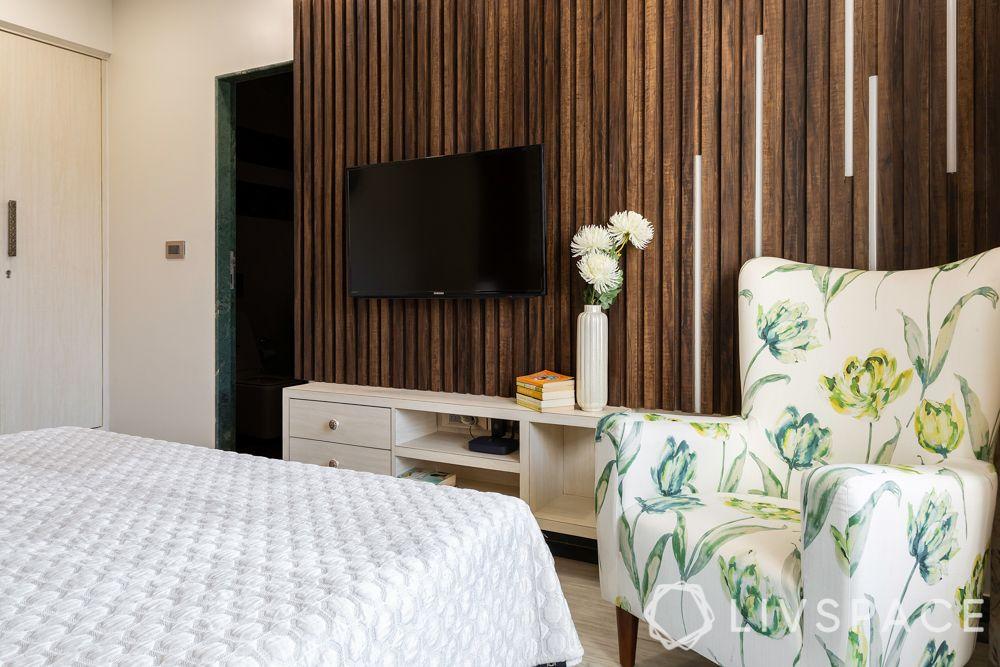mumbai flat-TV unit-wooden pattis-profile lights-accent chair