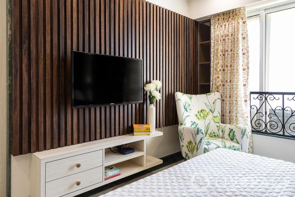 mumbai flat-TV unit-corner bookshelf-accent chair-wooden pattis