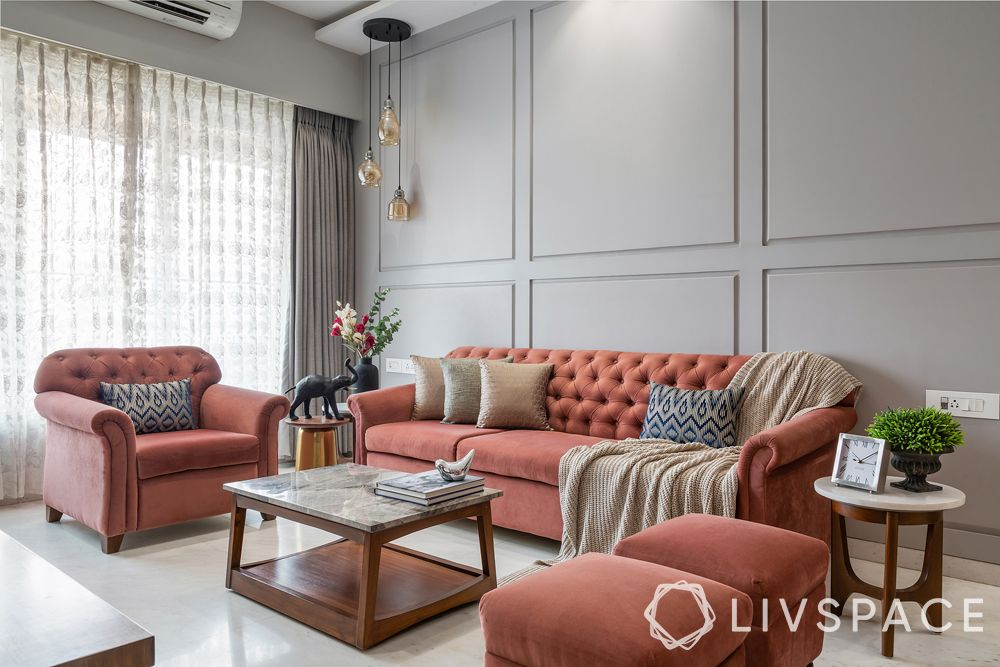 living room designs-transitional living room-wall grooves-Chesterfield sofa-pendant lights
