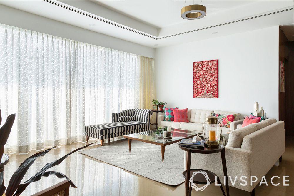 living room designs-rental living room-black and white bench-sofa-artwork