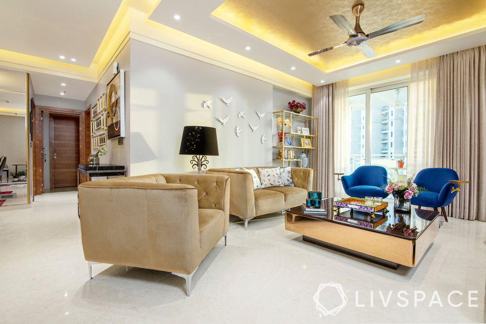 living room designs-velvet sofas-false ceiling-lighting