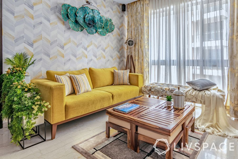 living room designs-yellow sofa-accent wall-wood centre table-nested stools