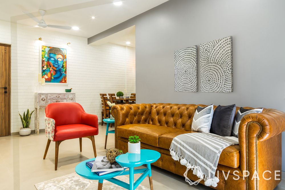 living room designs-Buddha painting-Chesterfield sofa-accent chair-turquoise blue centre table