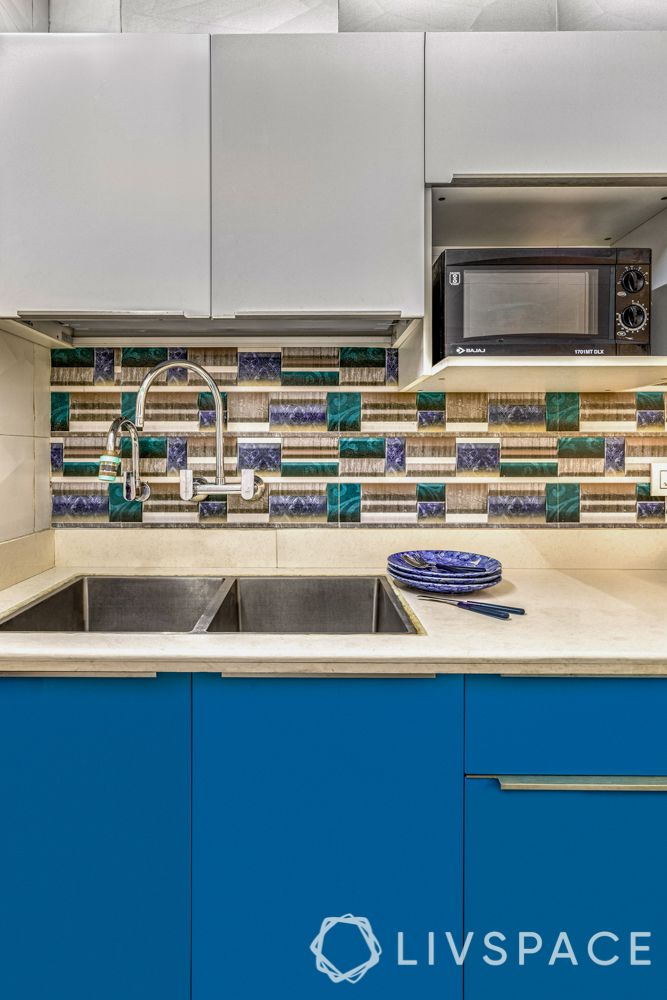 small-kitchen-interior-blue-storage-sink-cabinets-oven-unit