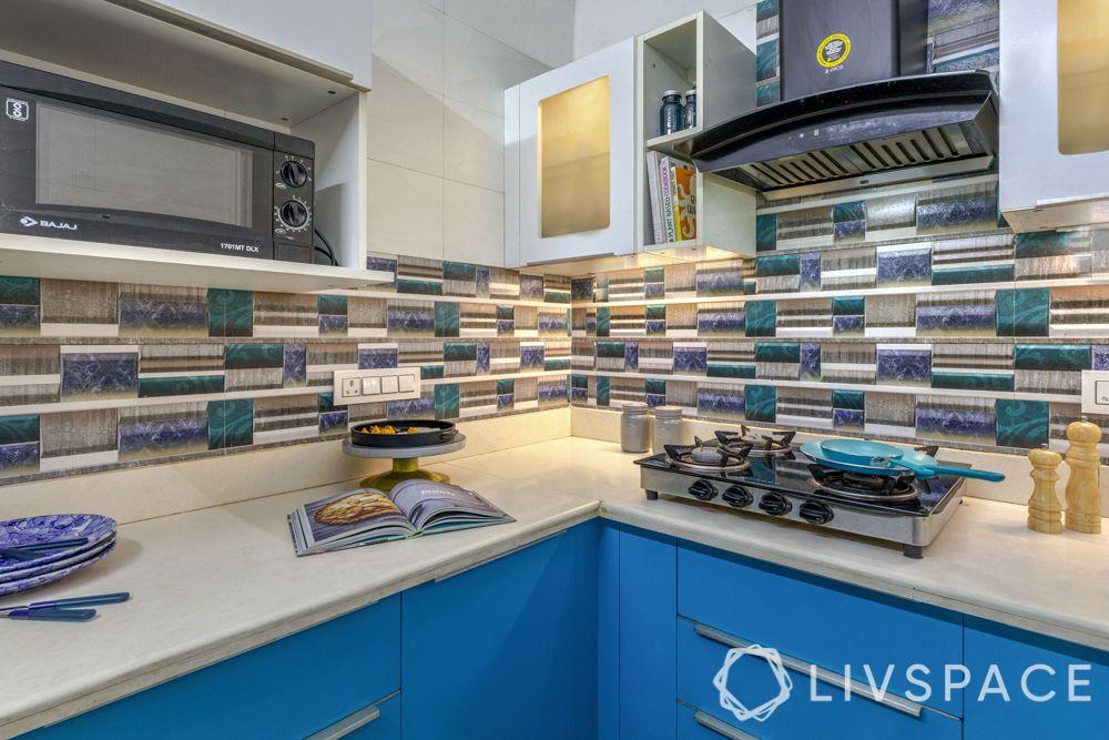 small-kitchen-interior-blue-white-storage-cream-counter-hob-chimney