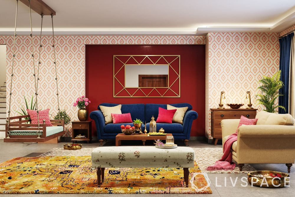 maximalism-red-white-wall-blue-couch-jhoola-yellow-rug