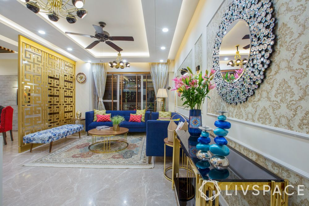 maximalism-living-room-noida-accent-mirror-gold-partition-blue-couch