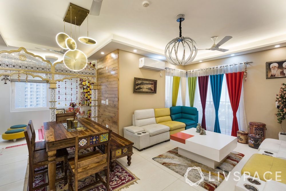 maximalism-living-room-3-bhk-dining-area-white-yellow-blue-sofa-colourful-curtains-pendant-lights