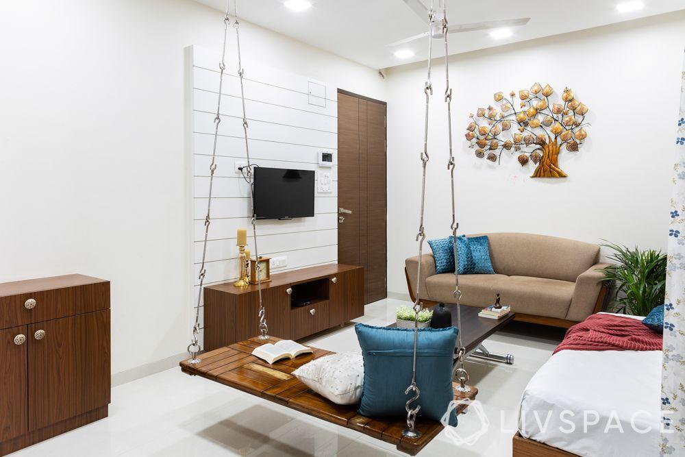 very small house design-living room-jhoola-seating-storage