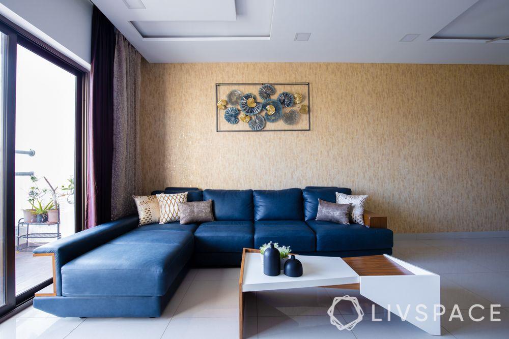 small house design ideas-L shaped blue sofa-refurbished sofa-accent wall