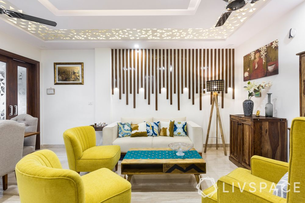 design small houses-living room-accent wall-false ceiling-yellow sofa-wooden furniture-tripod