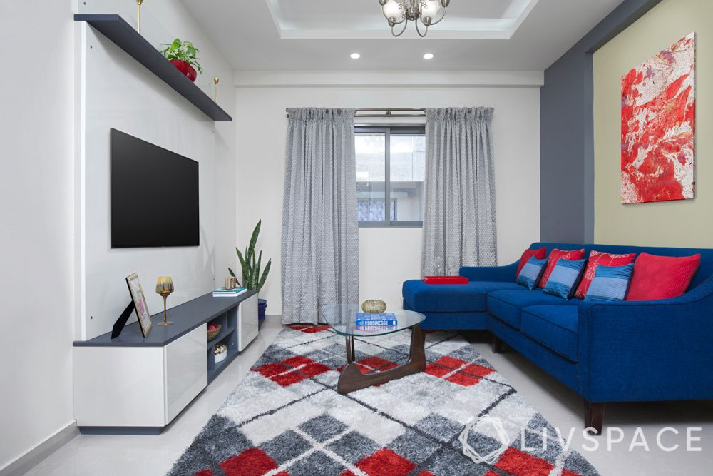 design small houses-living room-white interiors-blue sofa-TV unit