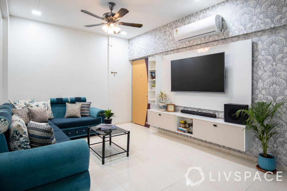 small house design ideas-living room-TV unit-accent wallpaper-blue sofa-false ceiling