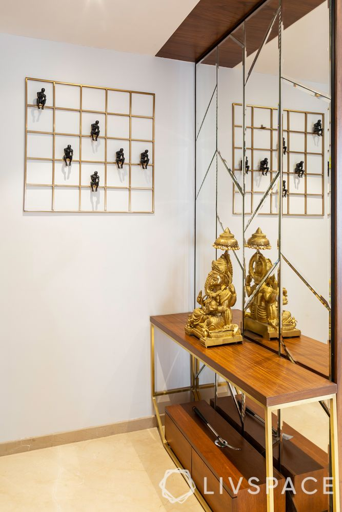 foyer decor_figurine-ganesha-console table-mirror-wall grid