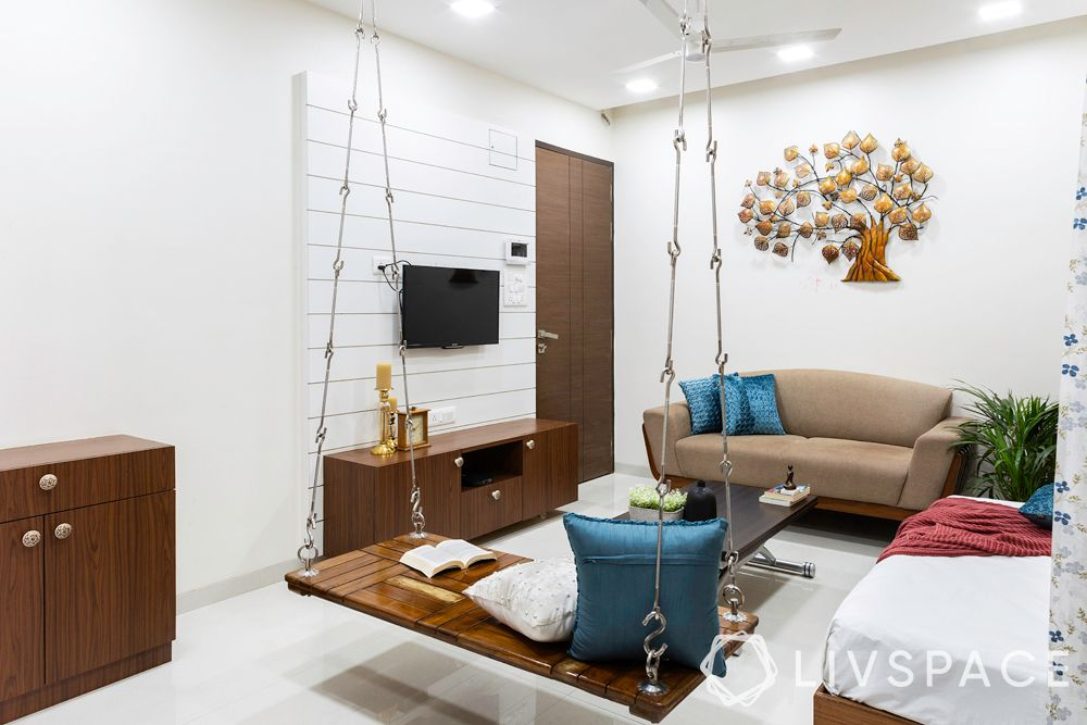 small modern house design-Mumbai home-living room-jhoola-seating-storage