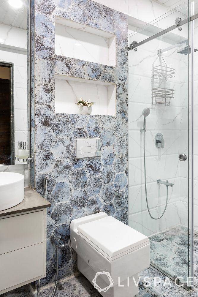 modern bathroom ideas–patterned hexagonal tiles–white sink