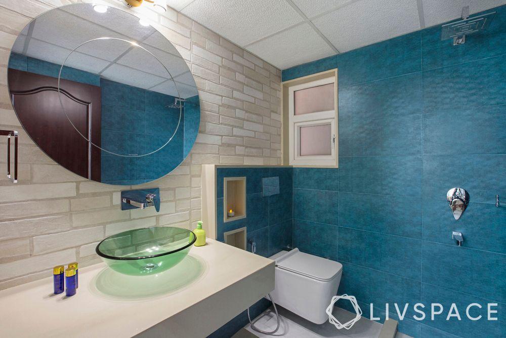 modern bathroom ideas–oval mirror–blue wall