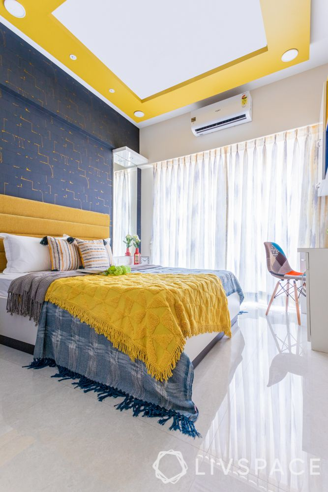 bedroom-colour-yellow-false-ceiling-midnight-blue-accent-wall