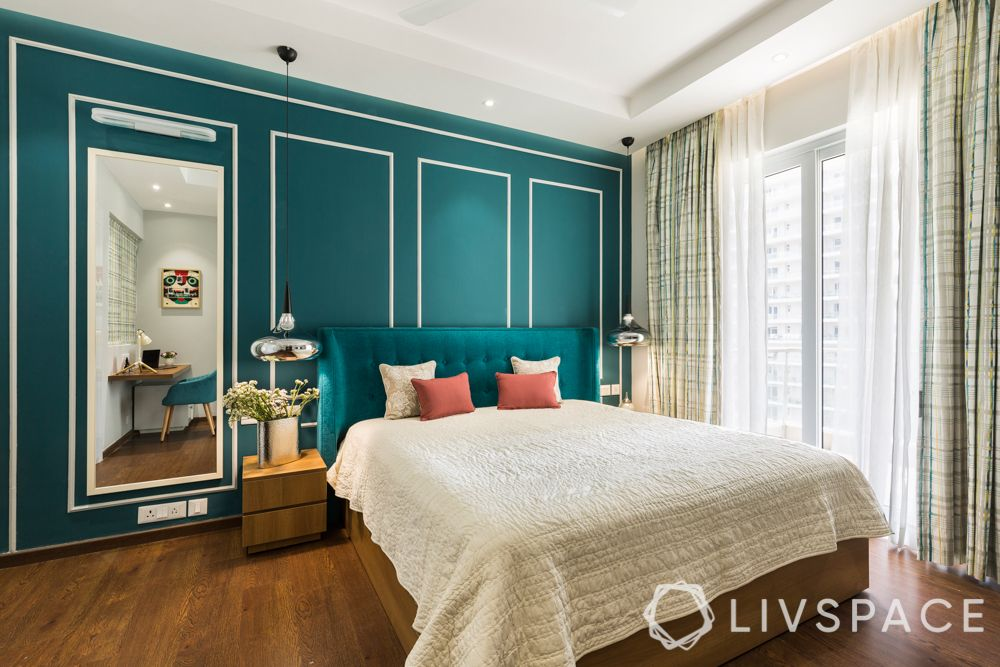 bedroom-colour-teal headboard-accent-wall-with-trims