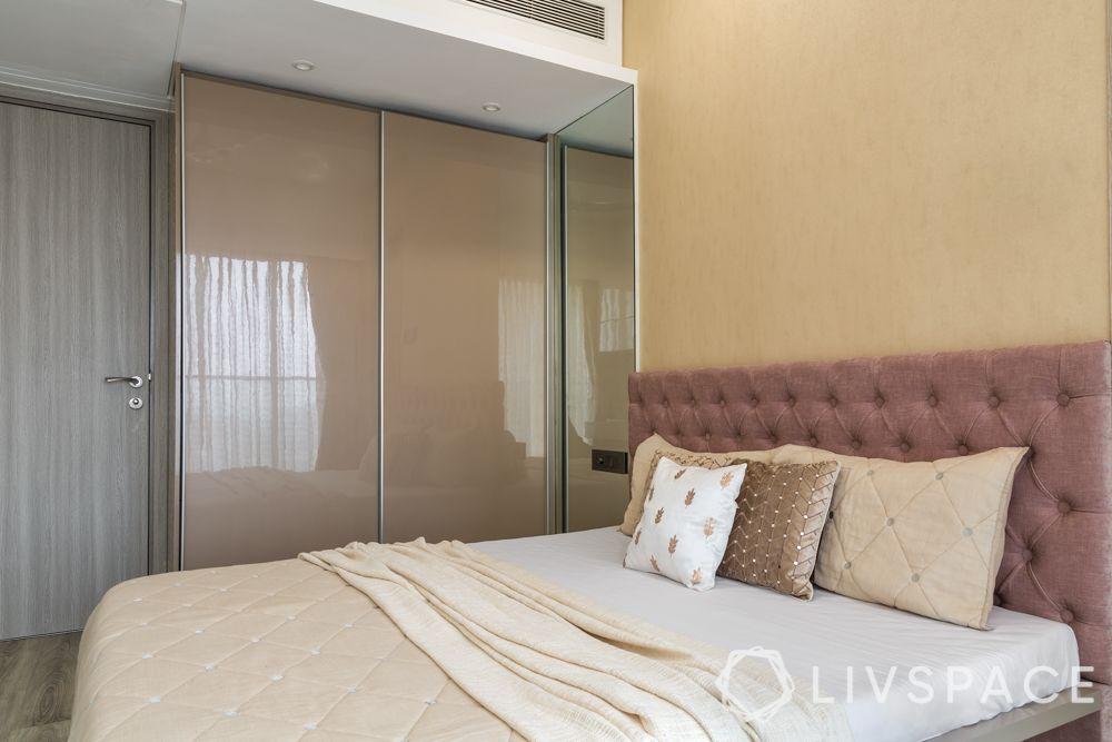 simple-bedroom-design-pink-headboard-neutral-tones