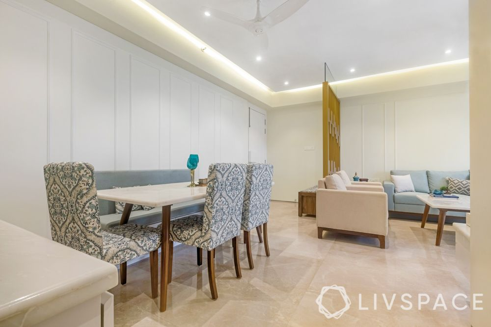 3 BHK flats in Mumbai-dining area-wall mouldings-false ceiling-profile lights