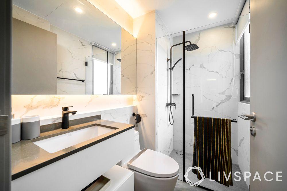 north-facing-house-vastu-plan-bathroom-white-marble-walls-glass-partition