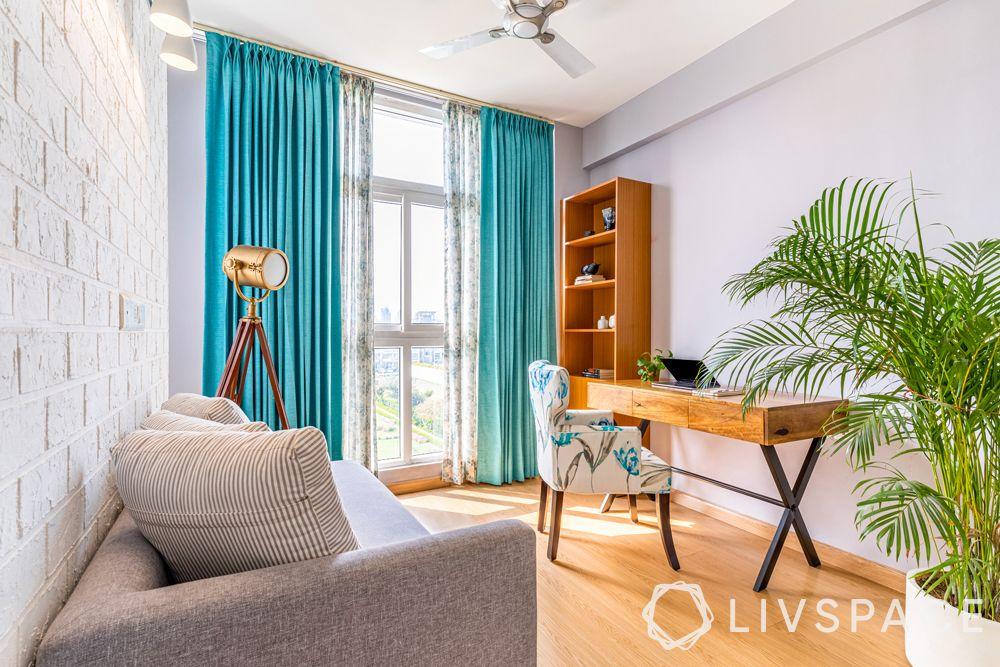 north-facing-house-vastu-plan-suitable-blue-curtains-wooden-flooring-stufy-desk-grey-couch
