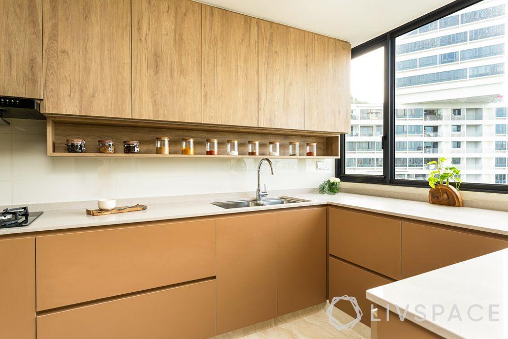 north-facing-house-vastu-plan-kitchen-wooden-cabinets-cream-countertop-brown-base-cabinets