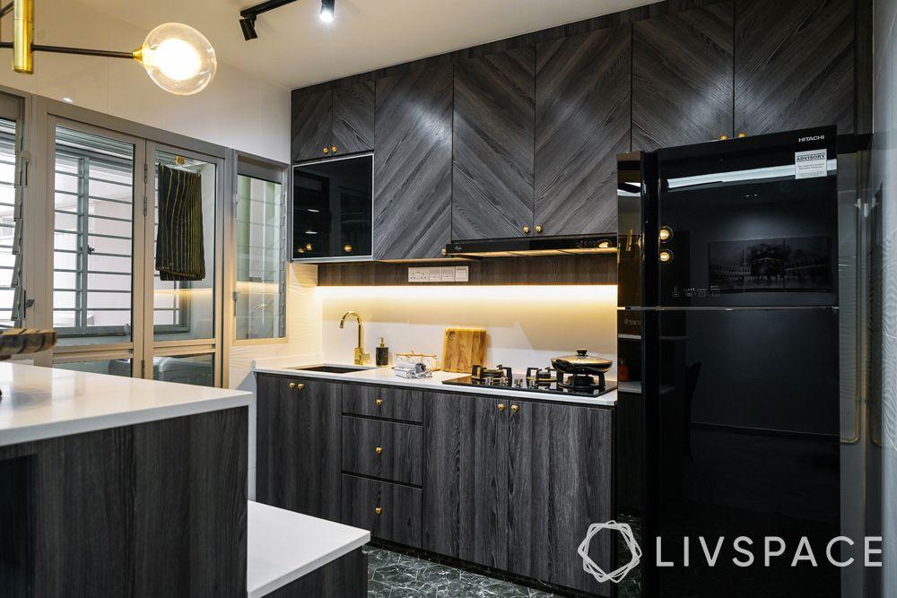 open kitchens-black kitchen-herringbone pattern cabinets