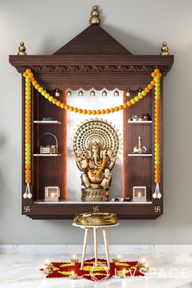 mandir designs for small flats-traditional triangular top-shelves