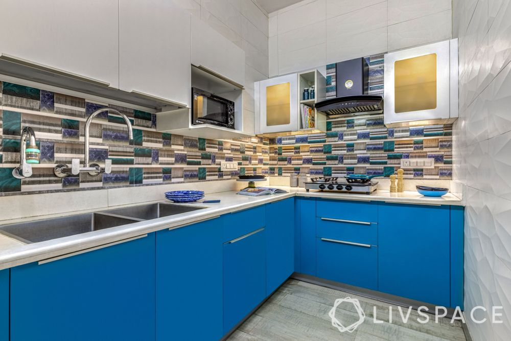 small kitchen designs-blue cabinets-profile lighting-backsplash