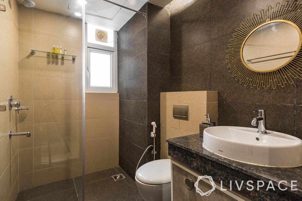 east-facing-house-vastu-plan-bathroom-white-basin-brown-interiors