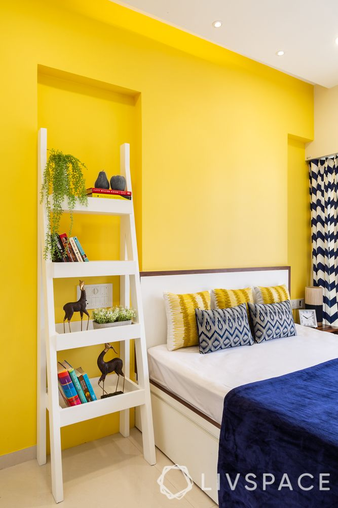 home-furniture-blue-sheets-yellow-walls