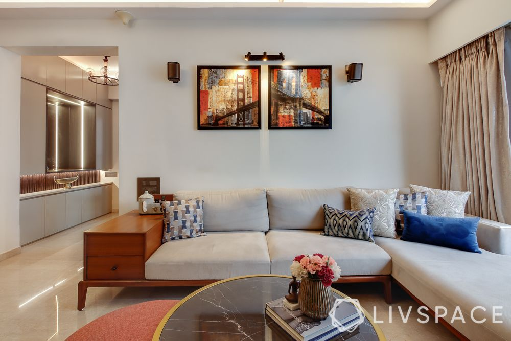 hometour-apartment-in-mumbai-living-room-solid-wood-sofa-white-walls-art