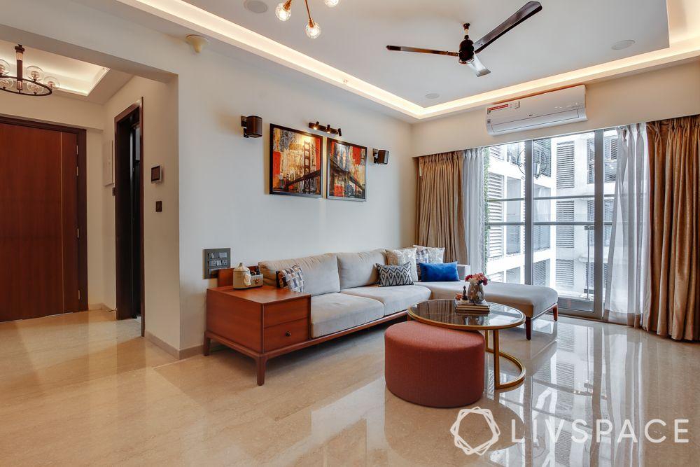 hometour-apartment-in-mumbai-living-room-solid-wood-sofa-metal-coffee-table