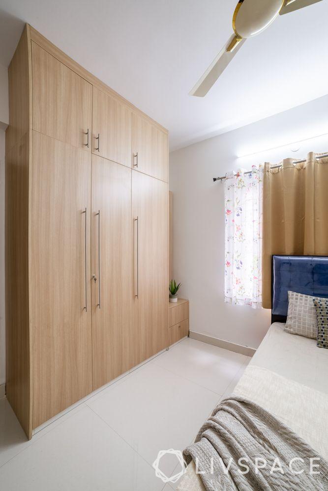3-bhk-interior-design-packages-laminate-swing-wardrobe-dresser