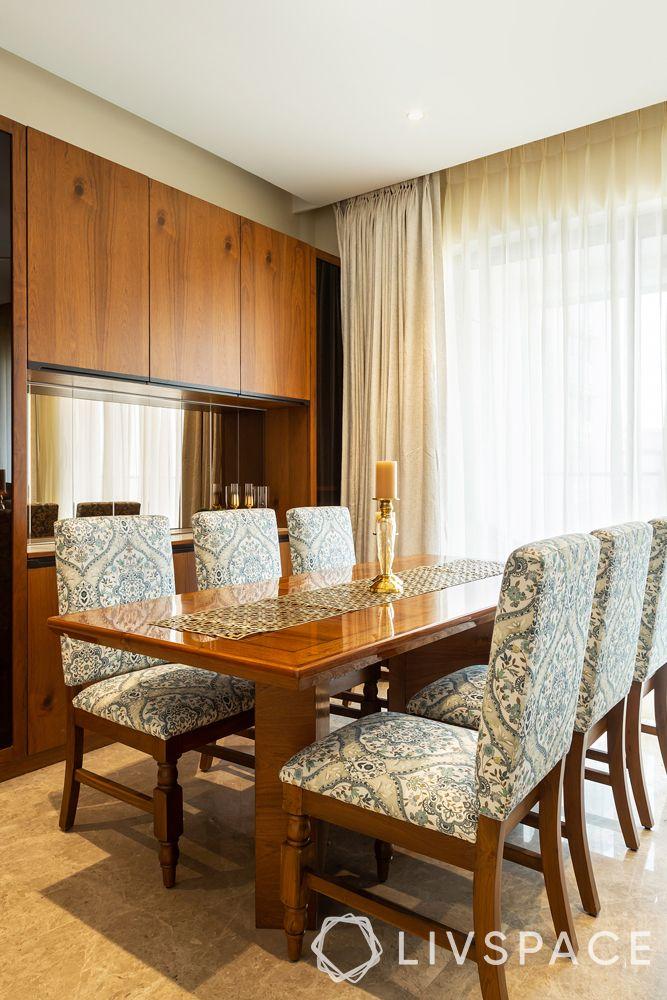 interior-of-3-BHK-flat-dining-room-veneer-crockery-unit
