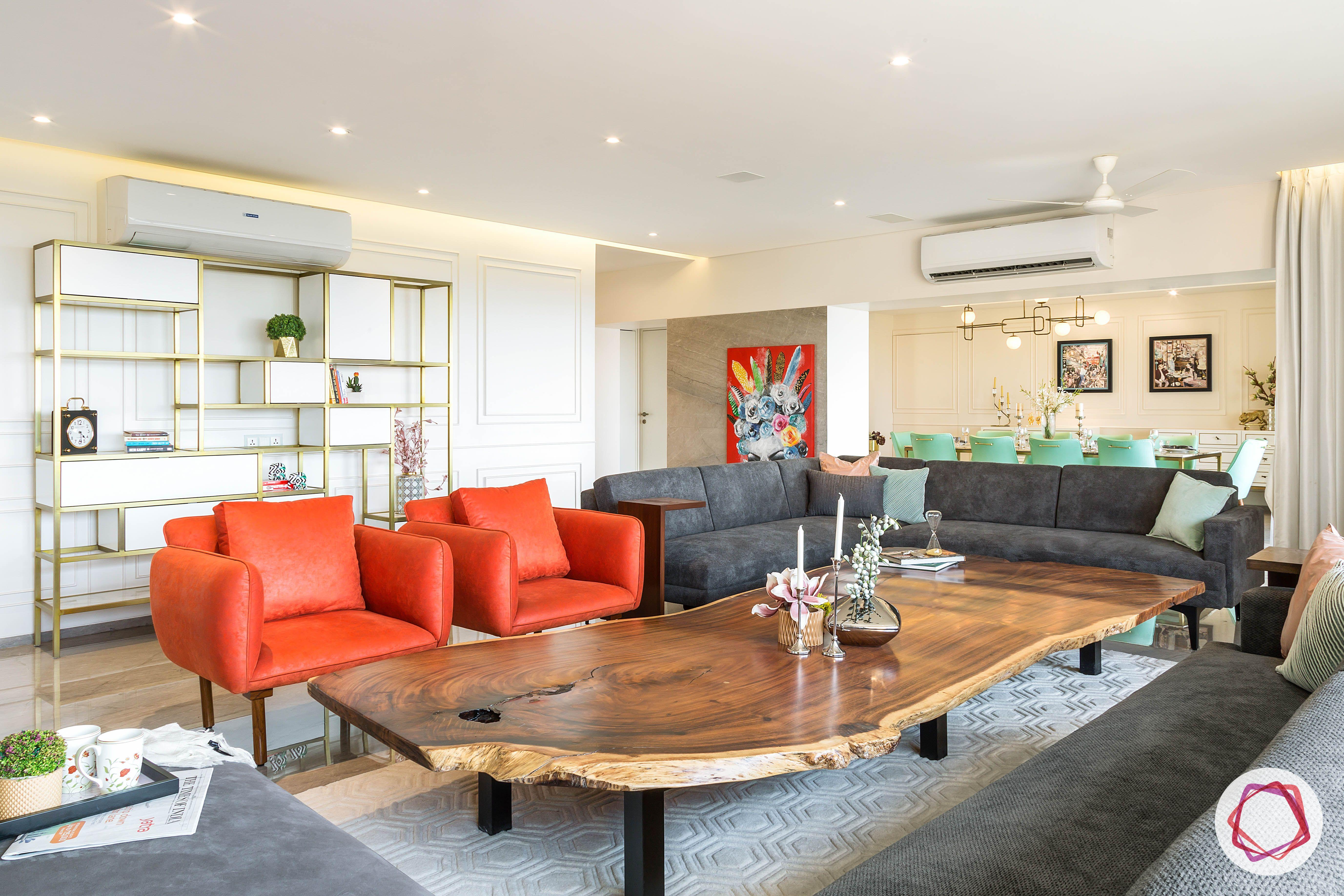 condo-interior-design-orange-armchair-designs-grey-sofa-designs
