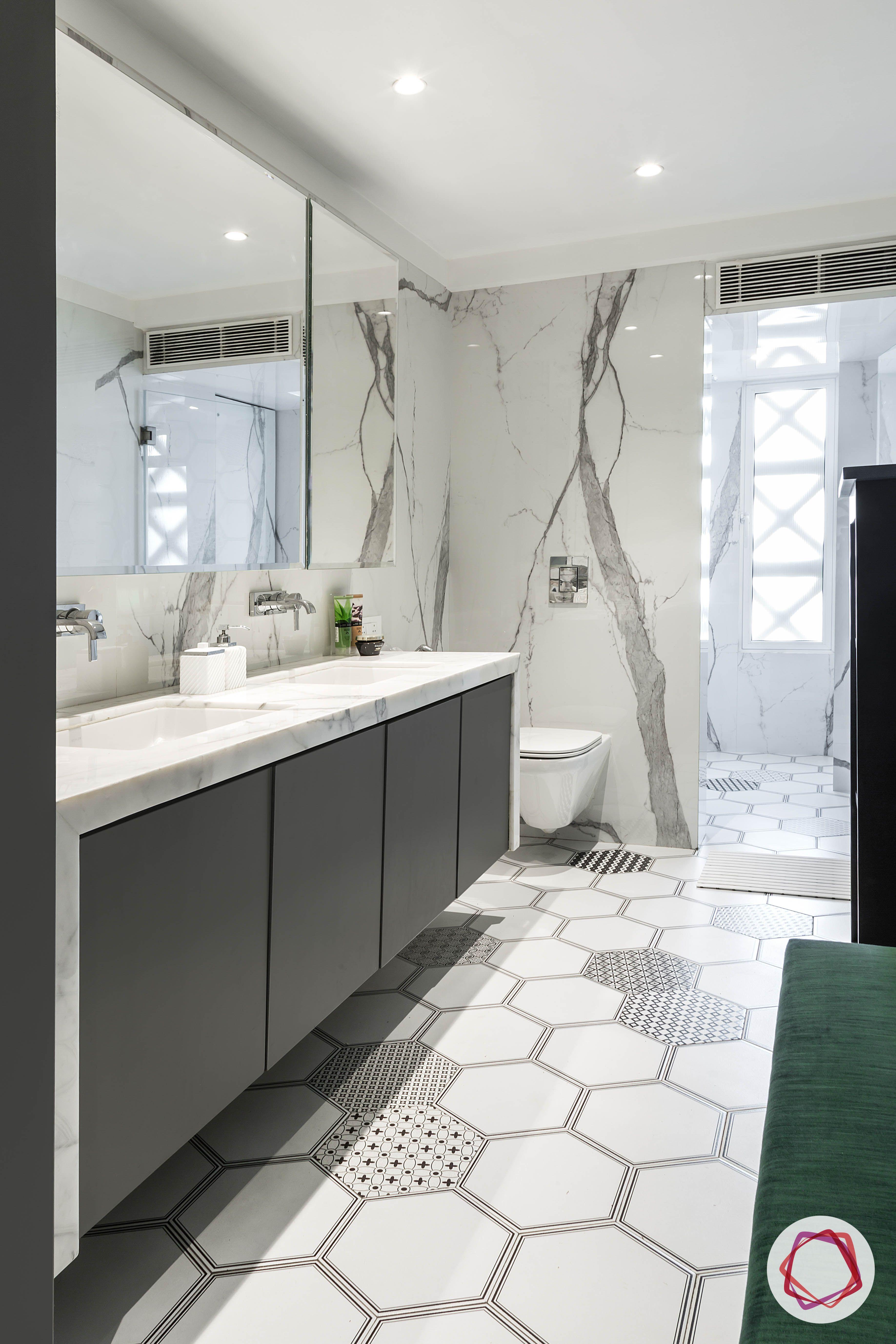 condo-interior-design-hexagonal-tiles-bathroom-grey-mirror