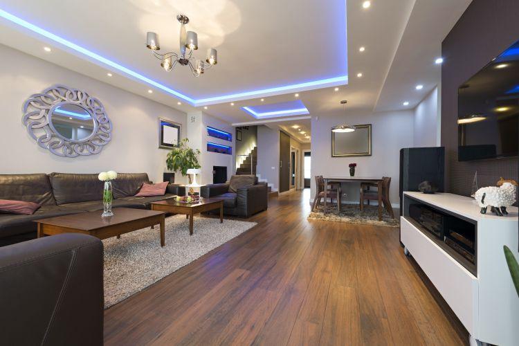 wooden flooring-tv-unit-living room-chandelier designs
