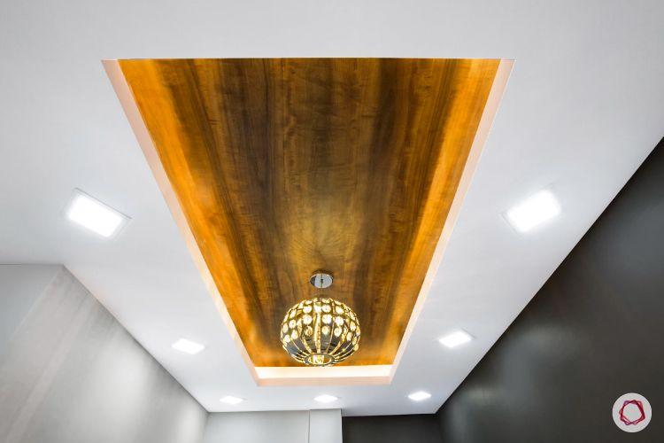 false ceiling lights-wooden panel-square lights-false ceiling-chandelier designs