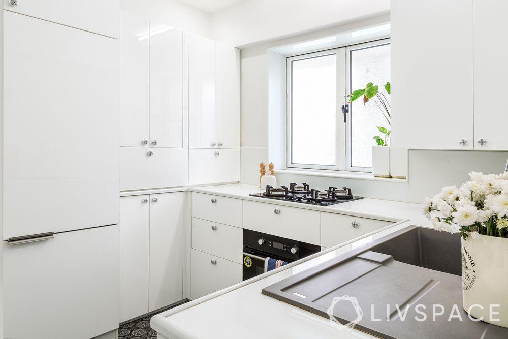 maintain white kitchens-white cabinets-plant vase-stove-kitchen window